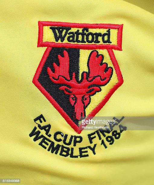 Watford club crest is seen on a retro shirt prior to the Emirates FA Cup sixth round match between Arsenal and Watford at Emirates Stadium on March...