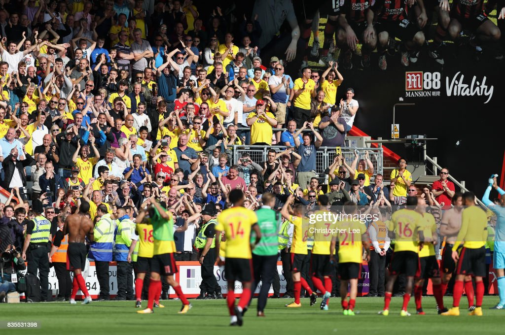 Watford fans celebrate victory with their players after the Premier League match between AFC Bournemouth and Watford at Vitality Stadium on August 19, 2017 in Bournemouth, England.