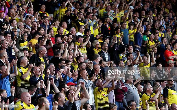 Watford fans cheer on their team during the Barclays Premier League match between Watford and Swansea City at Vicarage Road on September 12 2015 in...