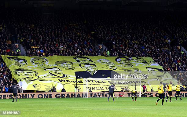 Watford fans display a banner as they pay tribute to former manager Graham Taylor who passed away at the age of 72 on Thursday prior to during the...