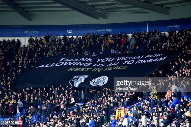 Watford fans display a banner in honour of Leicester City chairman Vichai Srivaddhanaprabha prior to the Premier League match between Leicester City...