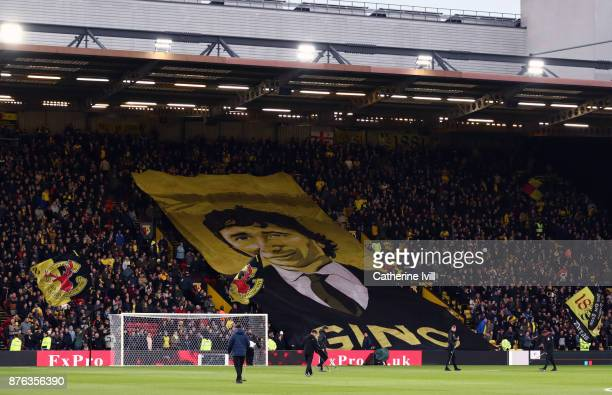 Watford fans display a banner showing owner Gino Pozzo before the Premier League match between Watford and West Ham United at Vicarage Road on...