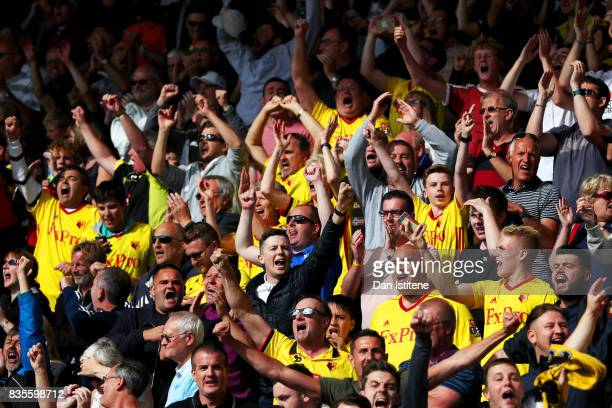 Watford fans enjoy the atmosphere during the Premier League match between AFC Bournemouth and Watford at Vitality Stadium on August 19 2017 in...