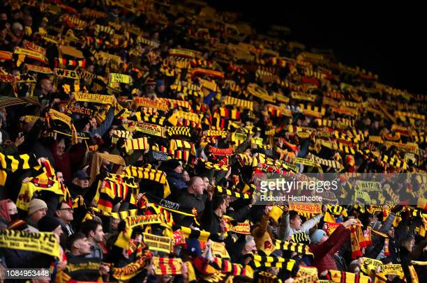 Watford fans hold up scarfs in memory of Graham Taylor prior to the Premier League match between Watford FC and Burnley FC at Vicarage Road on...