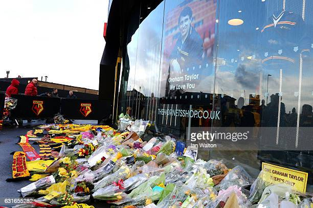 Watford fans leave tributes to Graham Taylor outisde the stadium prior the Premier League match between Watford and Middlesbrough at Vicarage Road on...