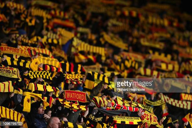 Watford fans raise their scarfs in memory of former manager Graham Taylor during the Premier League match between Watford FC and Burnley FC at...