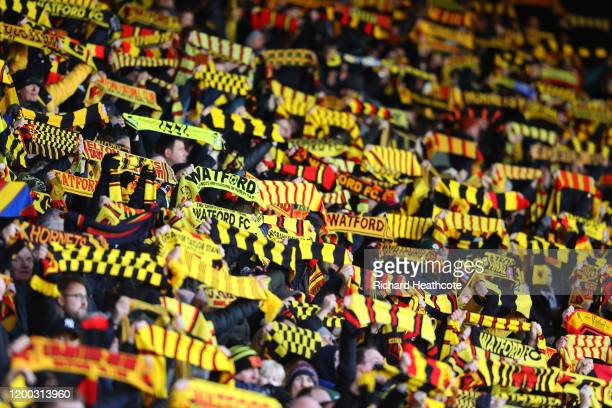 Watford fans show their support ahead of kick-off in the Premier League match between Watford FC and Tottenham Hotspur at Vicarage Road on January...