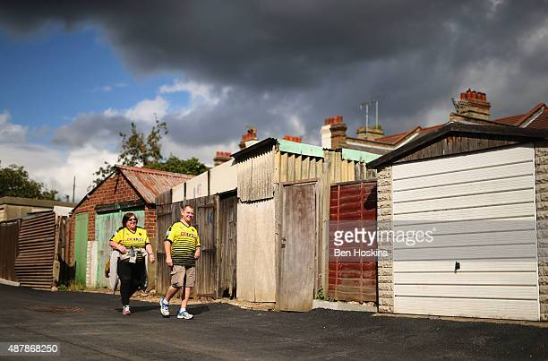 Watford fans walk outside the stadium prior to the Barclays Premier League match between Watford and Swansea City at Vicarage Road on September 12...