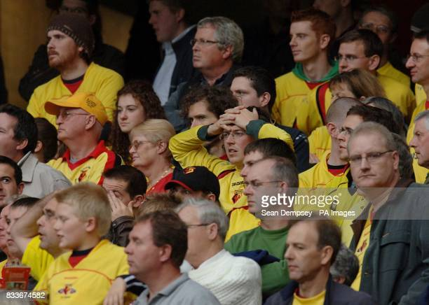 Watford fans watch the game dejected