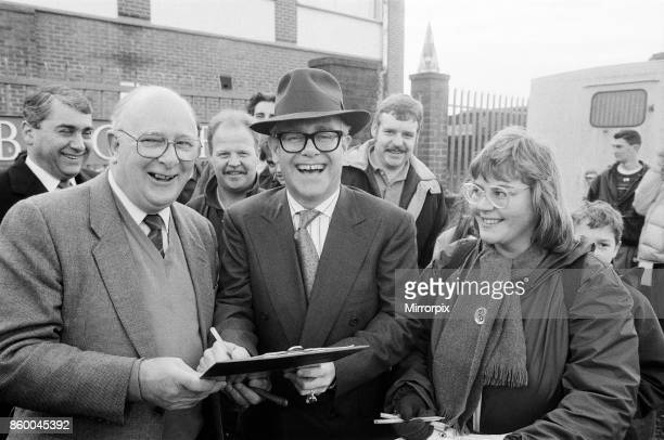 Watford FC Chairman Elton John and Birmingham MP and former Sports Minister Denis Howell sign a petition against the Government's proposed football...