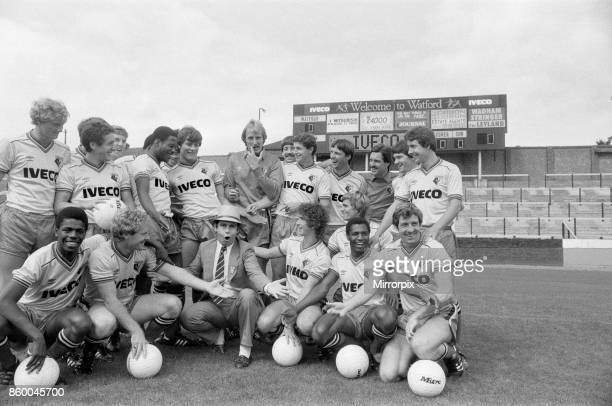 Watford FC chairman Elton John with Watford football team at a photocall, 29th August 1982.