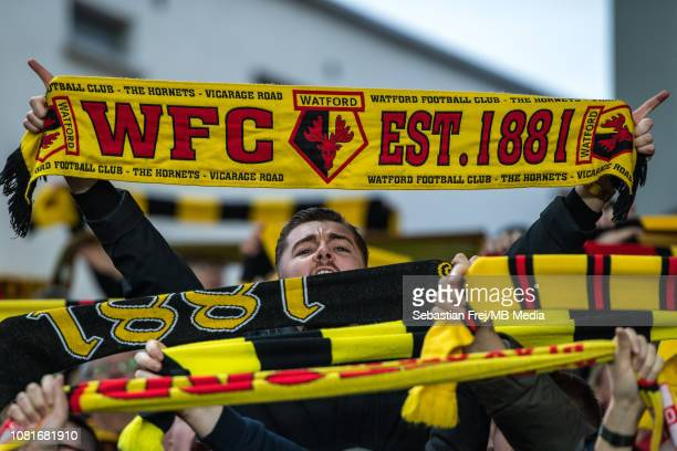 Watford FC fans hold up scarfs during the Premier League match between Crystal Palace and Watford FC at Selhurst Park on January 12 2019 in London...