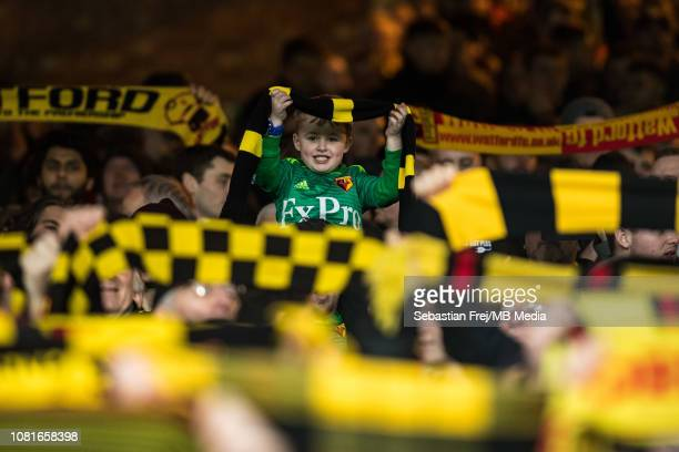 Watford FC fans hold up their scarfs during the Premier League match between Crystal Palace and Watford FC at Selhurst Park on January 12 2019 in...