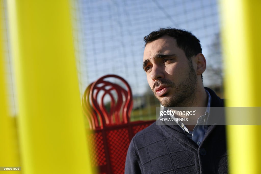 Watford FC player liaison officer, Lorenzo Libutti poses at the club's complex in London Colney on Janaury 25, 2018. - It should have been a welcome day off for Lorenzo Libutti and a chance to spend some time with his wife shortly before the birth of their second child. But then English Premier League club Watford appointed Spaniard Javi Gracia as their new manager -- their tenth since 2012 -- and Libutti was back at the club's Colney training ground, just north of London, to help the new boss and his backroom staff settle in. (Photo by ADRIAN DENNIS / AFP) / TO GO WITH AFP STORY by Julian GUYER
