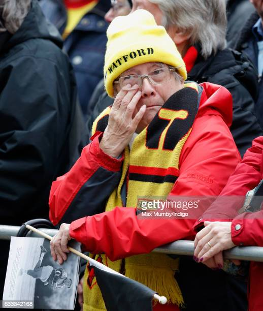 Watford Football Club fan attends the funeral of former England football manager Graham Taylor at St Mary's Church on February 1, 2017 in Watford,...