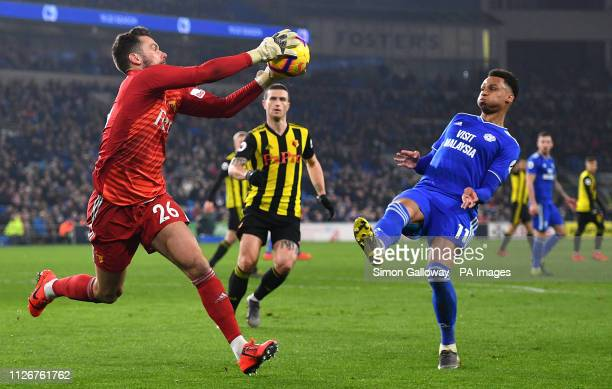 Watford goalkeeper Ben Foster and Cardiff City's Josh Murphy battle for the ball during the Premier League match at the Cardiff City Stadium.