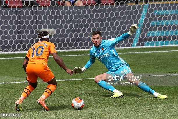 Watford goalkeeper Ben Foster closes down Allan Saint-Maximin of Newcastle during the Premier League match between Watford FC and Newcastle United at...
