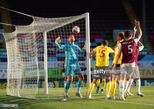 Watford goalkeeper Ben Foster looks on after a header from James Tarkowski of Burnley hits side netting during the Premier League match between...