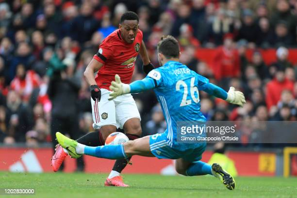 Watford goalkeeper Ben Foster saves from Anthony Martial of Man Utd during the Premier League match between Manchester United and Watford FC at Old...
