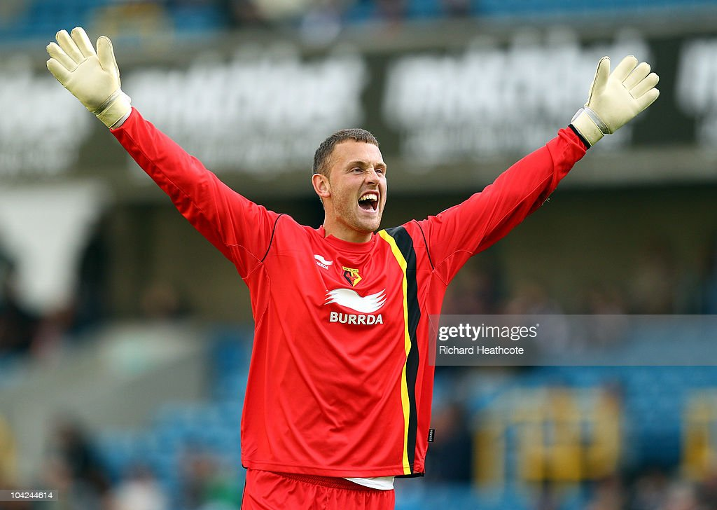 Watford goalkeeper Scott Loach celebrates as the sixth goal is scored during the npower Championship match between Millwall and Watford at The Den on September 18, 2010 in London, England.