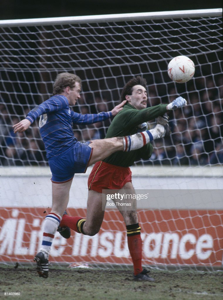 Watford goalkeeper Tony Coton punches the ball away from Chelsea striker David Speedie during their 1st Division match at Vicarage Road, 15th March 1985. Chelsea won 3-1. (Photo by Bob Thomas/Getty Images).