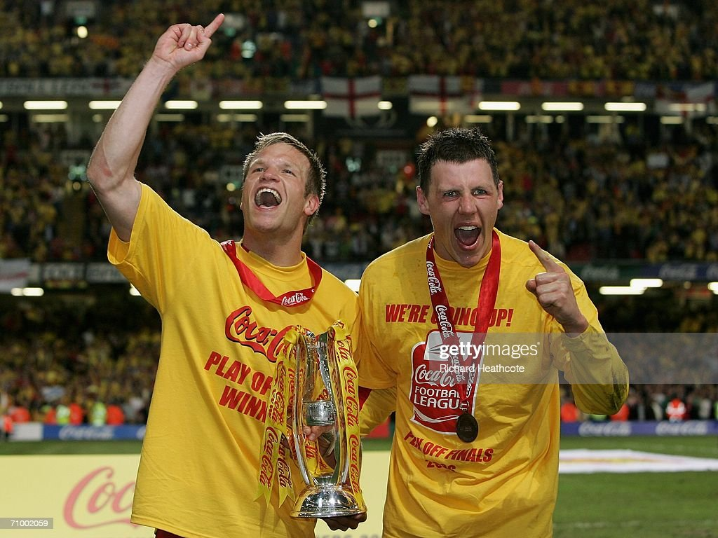 Watford Goalscorers Jay Demerit and Darius Henderson celebrate with the trophy following their Team's victory during the Coca-Cola Championship Playoff Final between Leeds United and Watford at the Millennium Stadium on May 21, 2006 in Cardiff, Wales.