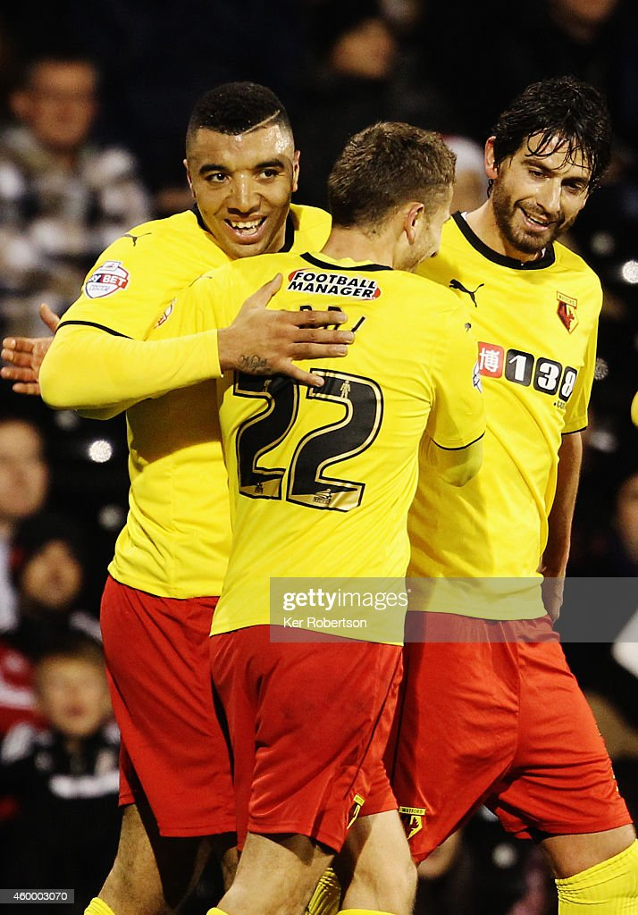 Watford goalscorers Troy Deeney and Almen Abdi celebrate during the Sky Bet Championship match between Fulham and Watford at Craven Cottage on December 5, 2014 in London, England.