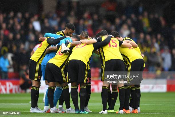 Watford huddle ahead of the Premier League match between Watford FC and Crystal Palace at Vicarage Road on August 26 2018 in Watford United Kingdom