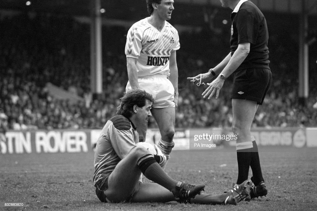 Watford Keeper Gary Plumley holds his ankle after colliding with Tottenham's Paul Allen