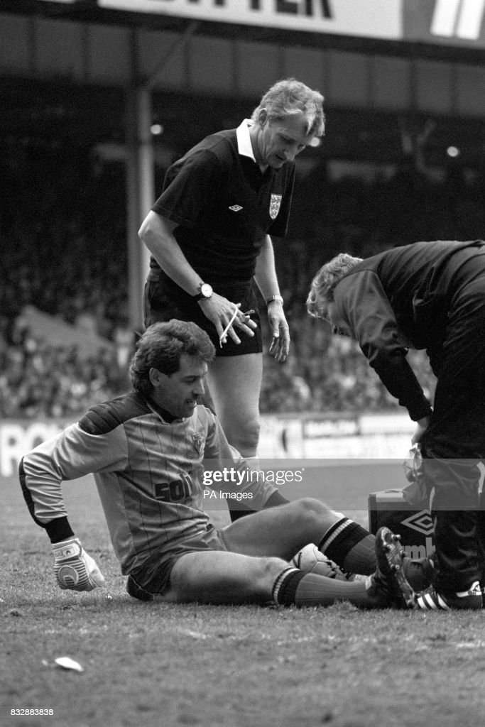 Watford Keeper Gary Plumley receives treatment after colliding with Tottenham's Paul Allen