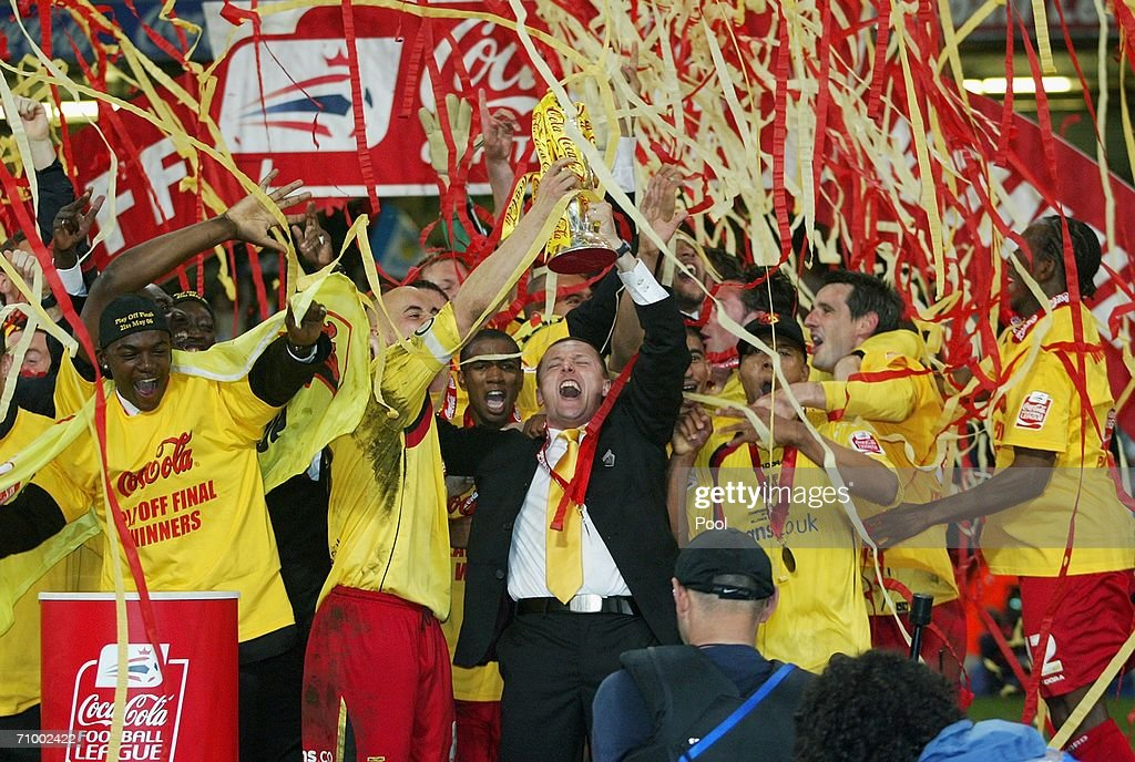 Watford Manager Adrian Boothroyd and his players celebrate with the trophy following their victory during the Coca-Cola Championship Playoff Final between Leeds United and Watford at the Millennium Stadium on May 21, 2006 in Cardiff, Wales.