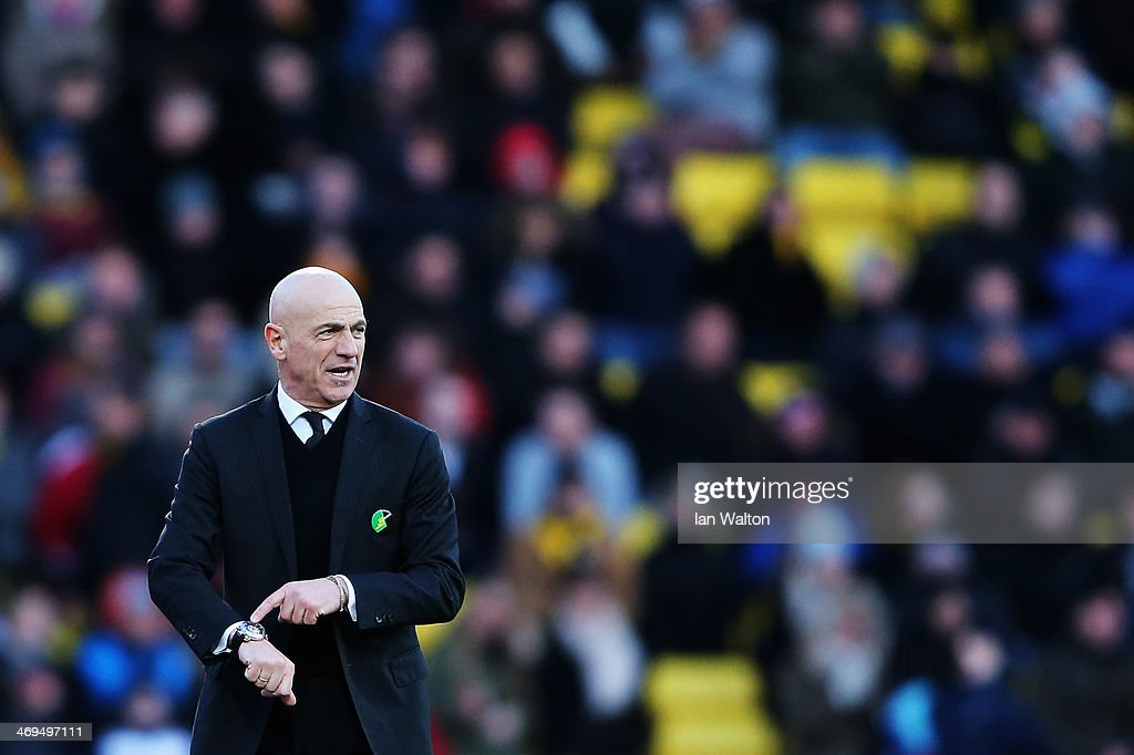 Watford manager Beppe Sannino checks his watch towards the end of the Sky Bet Championship match between Watford and Middlesbrough at Vicarage Road on February 15, 2014 in Watford, England.