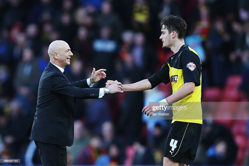 Watford manager Beppe Sannino congratulates Gabriele Angella of Watford at the end of the Sky Bet Championship match between Watford and Middlesbrough at Vicarage Road on February 15, 2014 in Watford, England.