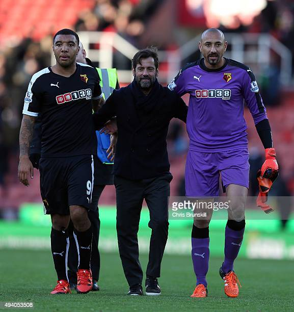 Watford manager Quique Sanchez Flores celebrates at fulltime with Troy Deeney and Heurelho Gomes following the Barclays Premier League match between...