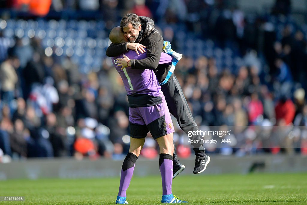 Watford Manager Quique Sanchez Flores celebrates with Heurelho Gomes at the end of the Barclays Premier League match between West Bromwich Albion and Watford at The Hawthorns on April 16, 2016 in West Bromwich, United Kingdom.