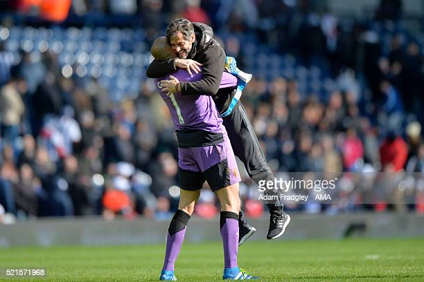 Watford Manager Quique Sanchez Flores celebrates with Heurelho Gomes at the end of the Barclays Premier League match between West Bromwich Albion and...