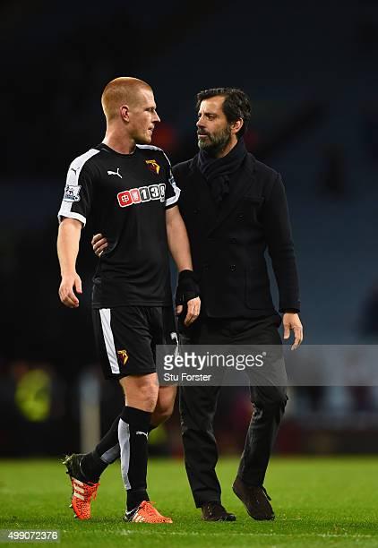Watford manager Quique Sanchez Flores congratulates player Ben Watson after the Barclays Premier League match between Aston Villa and Watford at...