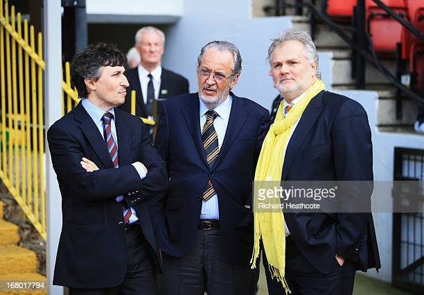 Watford owner Giampaolo Pozzo and son Gino talk to technical director Gianluca Nani after the npower Championship match between Watford and Leeds...