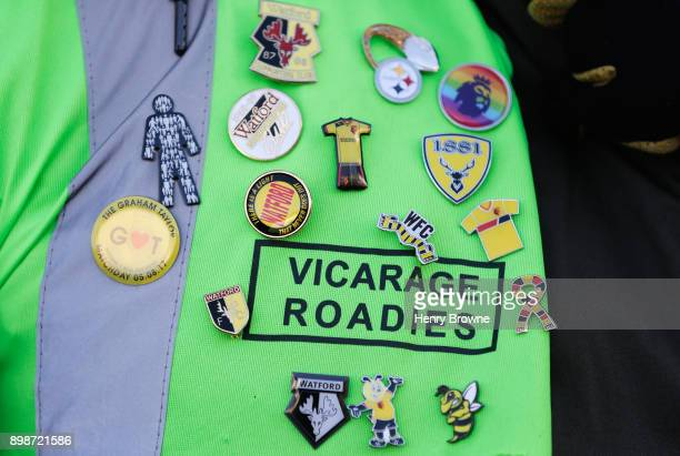 Watford pin badges are pictured on a stewards bib prior to the Premier League match between Watford and Leicester City at Vicarage Road on December...