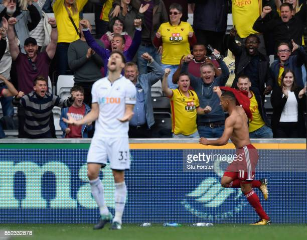 Watford player Richarlison celebrates the winning goal as Federico Fernandez of Swansea reacts during the Premier League match between Swansea City...