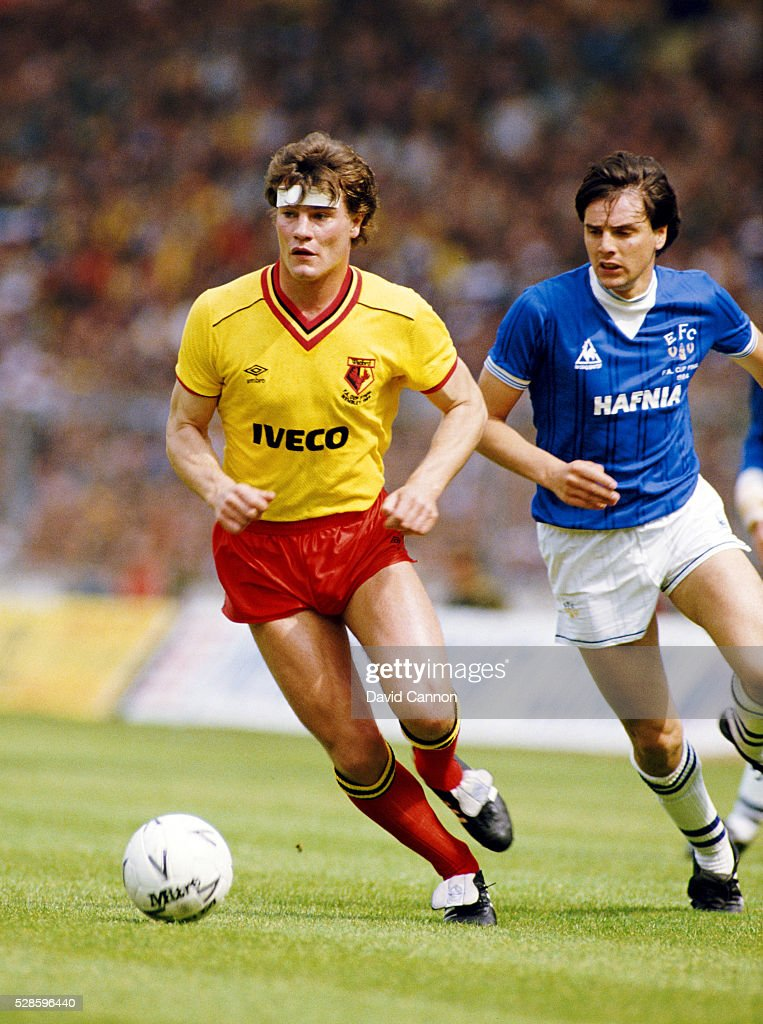 Watford player Steve Terry (l) holds off the challenge of Everton striker Graeme Sharp during the 1984 FA Cup Final at Wembley Stadium on May 19, 1984 in London, England.