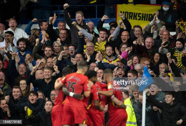 Watford players celebrate in front of their fans after Juraj Kucka scores their second goal during the Premier League match between Everton and...