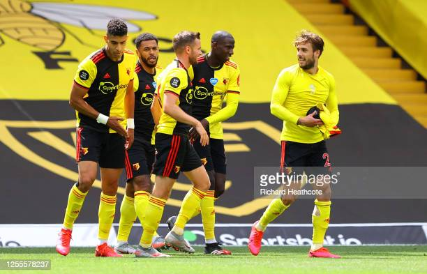Watford players celebrate on the final whistle following the Premier League match between Watford FC and Newcastle United at Vicarage Road on July 11...