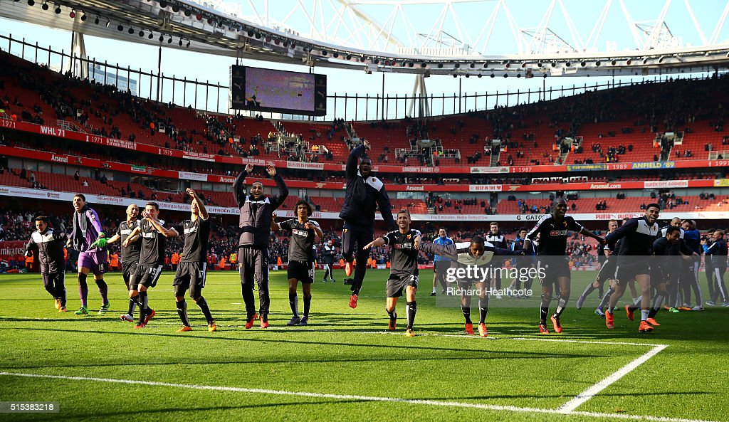 Watford players celebrate victory after the Emirates FA Cup sixth round match between Arsenal and Watford at Emirates Stadium on March 13, 2016 in London, England.