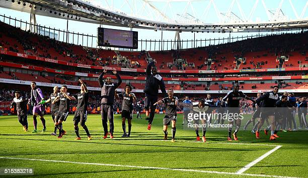 Watford players celebrate victory after the Emirates FA Cup sixth round match between Arsenal and Watford at Emirates Stadium on March 13 2016 in...