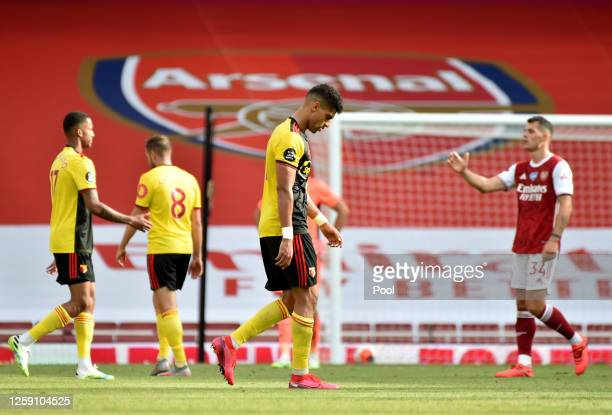 Watford players look dejected after the Premier League match between Arsenal FC and Watford FC at Emirates Stadium on July 26, 2020 in London,...