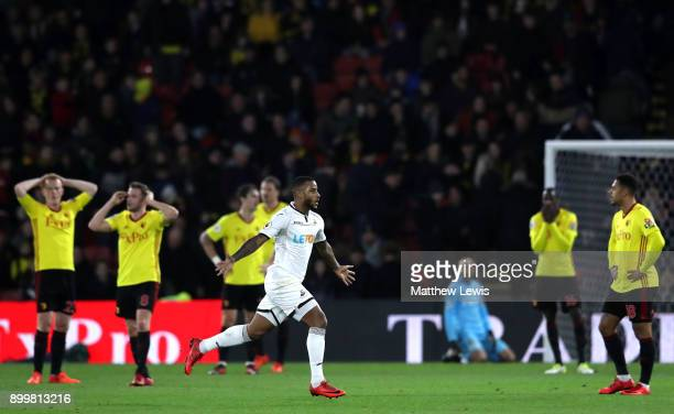 Watford players look dejected as Luciano Narsingh of Swansea City celebrates after scoring his sides second goal during the Premier League match...
