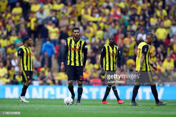 Watford players look dejected during the FA Cup Final match between Manchester City and Watford at Wembley Stadium on May 18, 2019 in London, England.