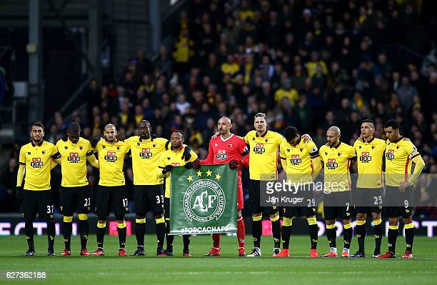 Watford players observe a minutes silence for the victims of the plane crash involving the Brazilian club Chapecoense prior the Premier League match...