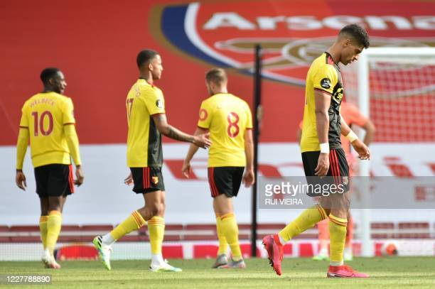 Watford players react after losing the English Premier League football match between Arsenal and Watford at the Emirates Stadium in London on July...